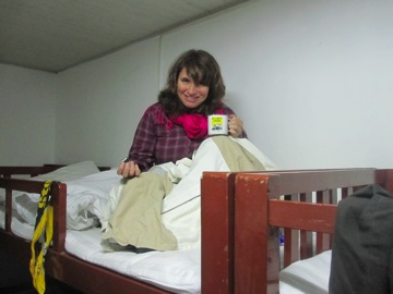 Kristine tucking into the top bunk at the top of Hua Shan Mountain, Xi'an, China