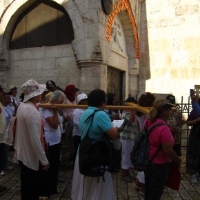 Tourists recreating Christ's crucifixion